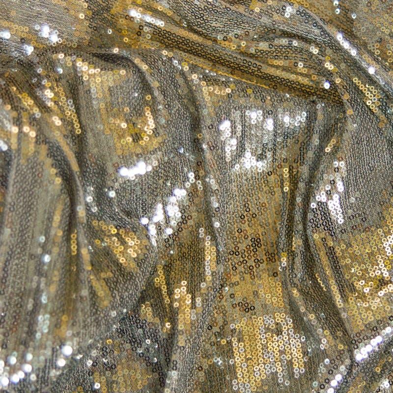 Argent, texture de tissu d'or avec des paillettes image libre de droits