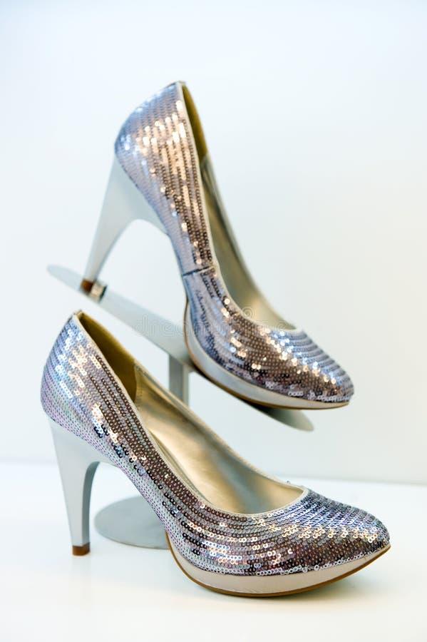 Argentate stiletto high heels. On white background royalty free stock photos