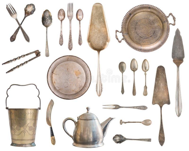 Argenterie de cru, cuill?res antiques, fourchettes, couteaux, poche, pelles ? g?teau, bouilloire, plateau et seau ? glace d'isole images libres de droits