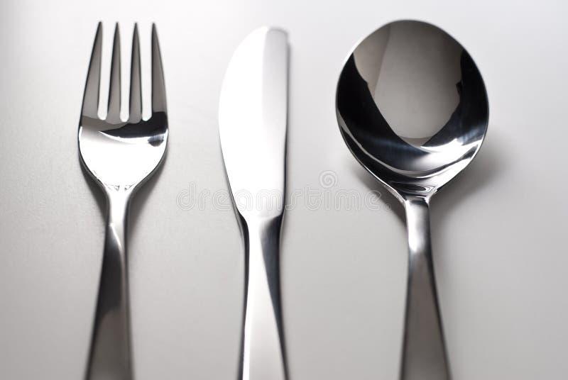 Argenterie de fourchette, de couteau et de cuillère images libres de droits