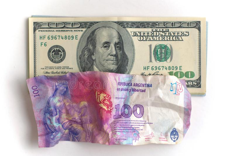 Argentina economic crisis and currency devaluation concept. Crumpled argentinian banknote and intact US banknotes. Argentina economic crisis and currency stock images