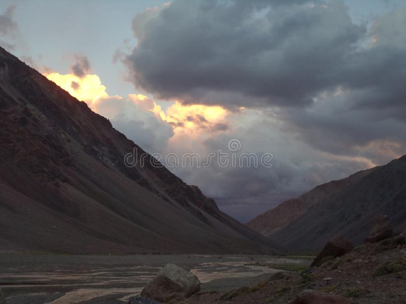 Argentina - Famous peaks - Hiking in Cantral Andes - Peaks around us - evening clouds on the base camp. Argentina - Hiking in Central Andes -Famous Peaks - Peaks stock photography