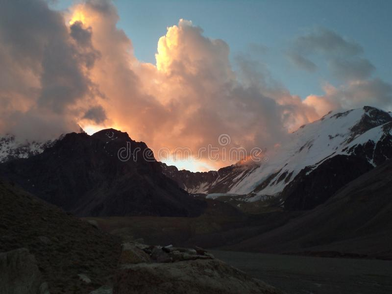 Argentina - Famous peaks - Hiking in Cantral Andes - Peaks around us - evening clouds on the base camp. Argentina - Hiking in Central Andes -Famous Peaks - Peaks stock image