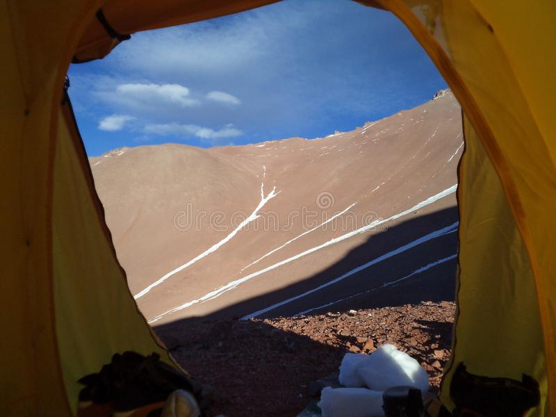 Argentina - Famous peaks - Hiking in Cantral Andes - clouds in the morning below the camp. Argentina - Hiking in Central Andes -Famous Peaks - Peaks around us stock photos