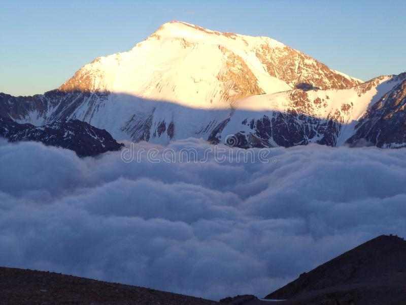 Argentina - Famous peaks - Hiking in Cantral Andes - clouds in the morning below the camp. Argentina - Hiking in Central Andes -Famous Peaks - Peaks around us royalty free stock photos