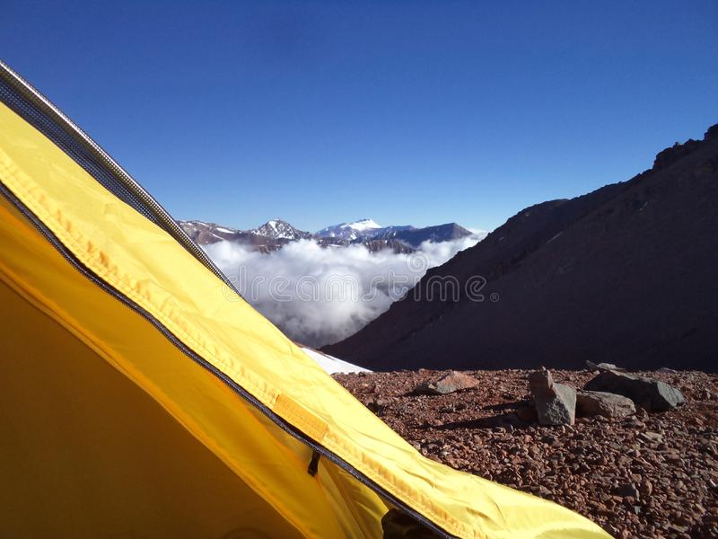 Argentina - Famous peaks - Hiking in Cantral Andes - clouds in the morning below the camp. Argentina - Hiking in Central Andes -Famous Peaks - Peaks around us stock image