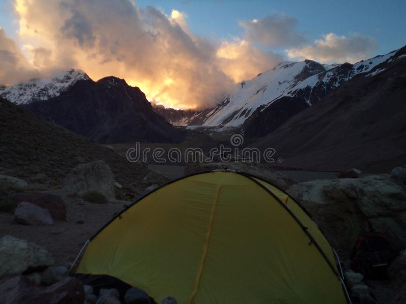 Argentina - Famous peaks - Hiking in Cantral Andes - Peaks around us - evening clouds on the base camp. Argentina - Hiking in Central Andes -Famous Peaks - Peaks stock photo