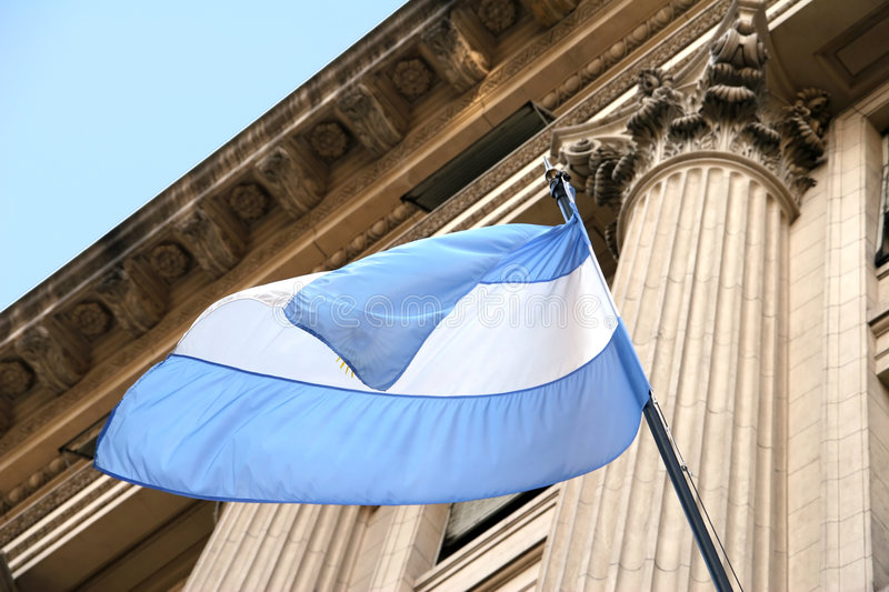 Argentina Flag. Waving in the wind with old building in background stock image