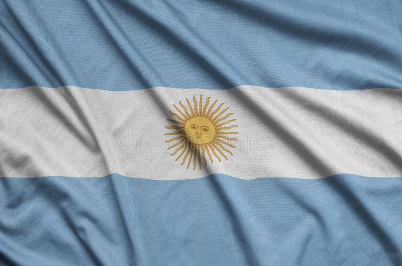 Argentina flag is depicted on a sports cloth fabric with many folds. Sport team banner. Argentina flag is depicted on a sports cloth fabric with many folds royalty free stock images
