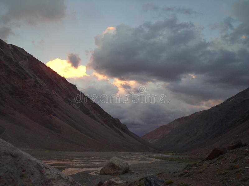 Argentina - Famous peaks - Hiking in Cantral Andes - Peaks around us - evening clouds on the base camp. Argentina - Hiking in Central Andes -Famous Peaks - Peaks stock photos