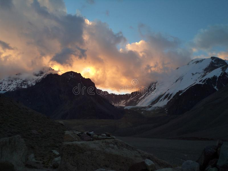 Argentina - Famous peaks - Hiking in Cantral Andes - Peaks around us - evening clouds on the base camp. Argentina - Hiking in Central Andes -Famous Peaks - Peaks royalty free stock photos