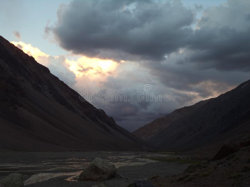 Argentina - Famous peaks - Hiking in Cantral Andes - Peaks around us -Evening clouds over the base camp. Argentina - Hiking in Central Andes -Famous Peaks stock photography
