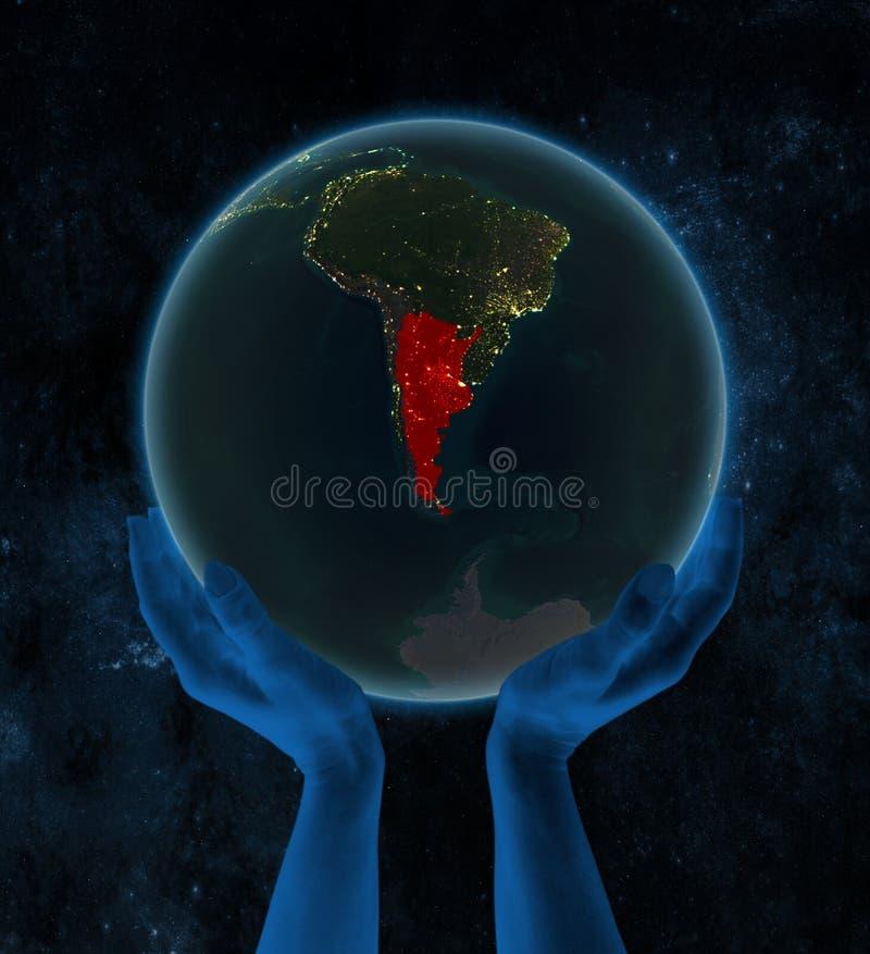 Argentina på nattjord i händer i utrymme vektor illustrationer