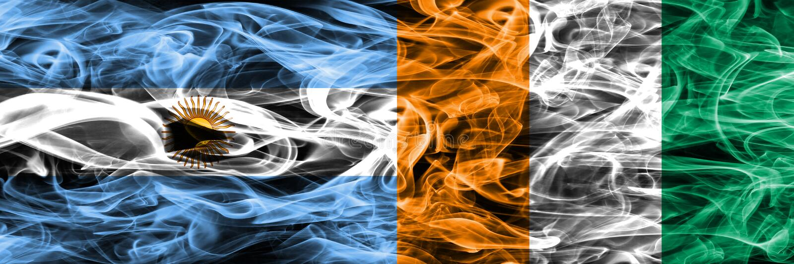 Argentina vs Ivory Coast smoke flags placed side by side. Thick royalty free stock image