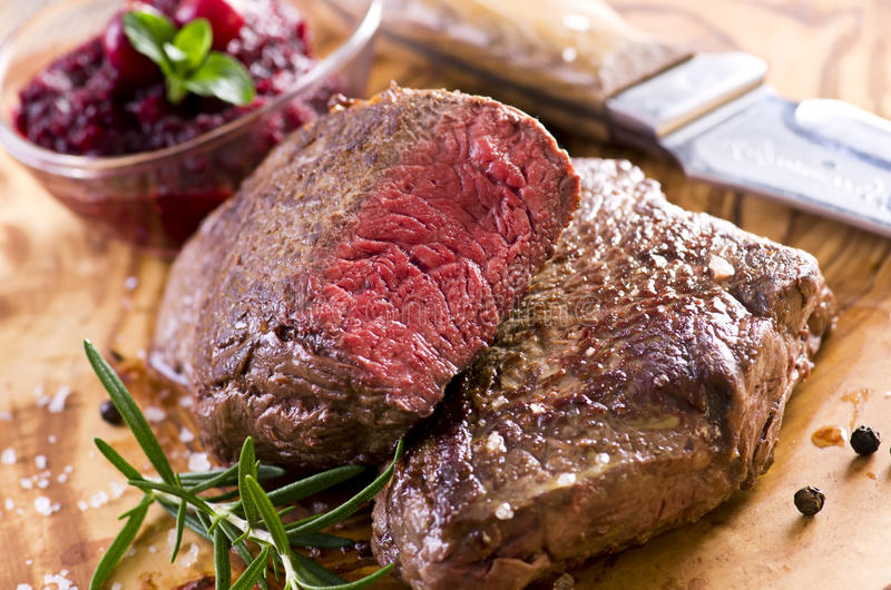 Argentinian Beef Steaks. As closeup on a wooden plate royalty free stock images