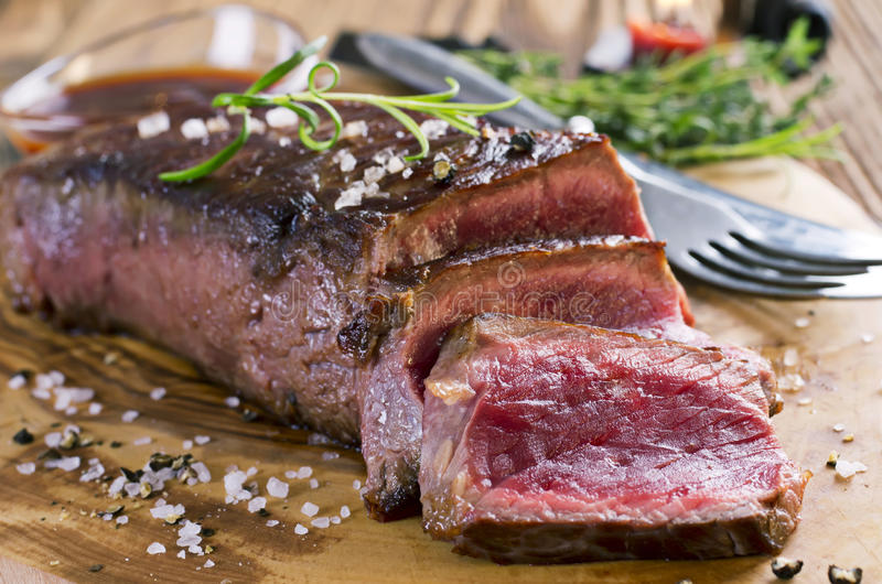 Argentinian Beef Steaks. Argentinian beef steak as closeup on a wooden board stock image