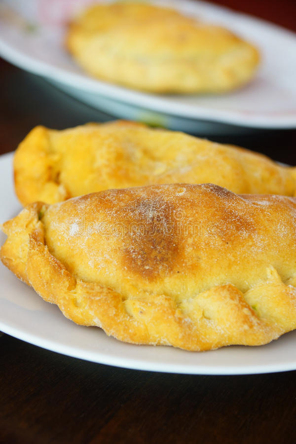 Argentinian empanadas. Served on a white plate royalty free stock image