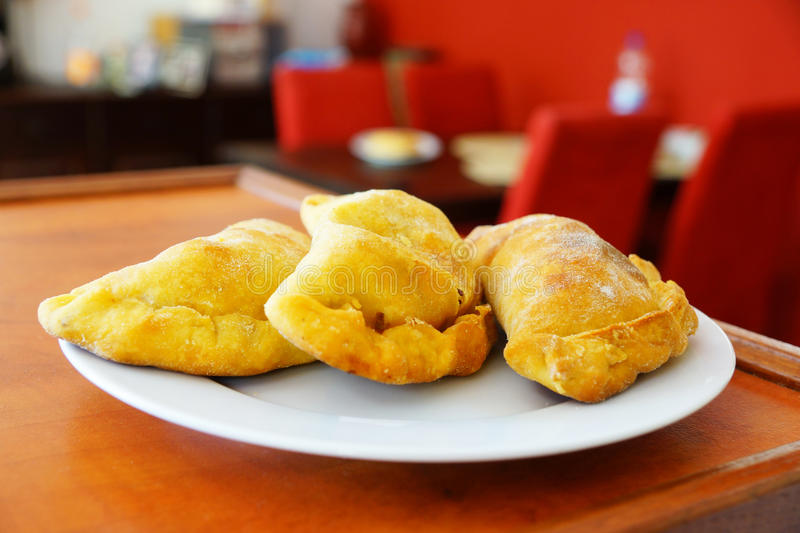 Argentinian empanadas. Served on a white plate royalty free stock photography