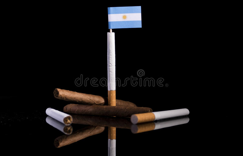 Argentinian flag with cigarettes. And cigars. Tobacco Industry concept stock images