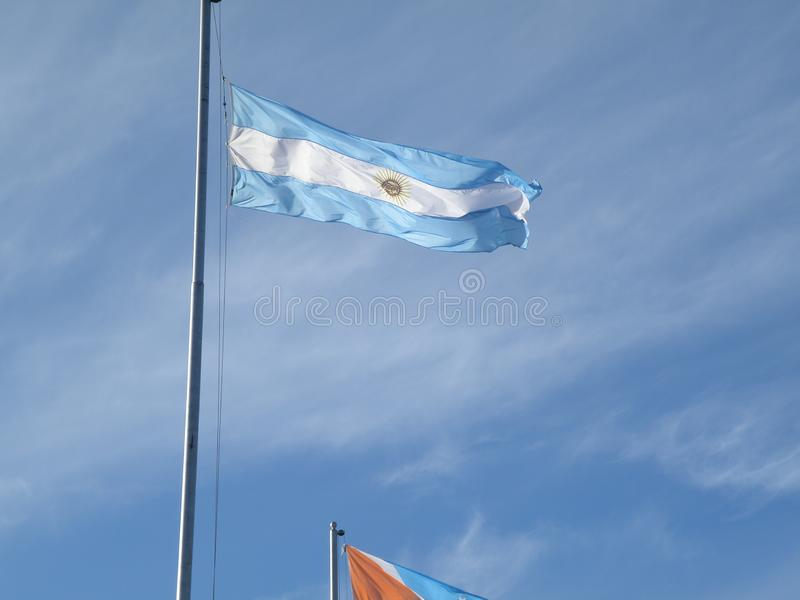 Argentinian flag ondulated by the windy wheather. Argentinian flag being moved by the windy wheather with blue sky on the background royalty free stock images