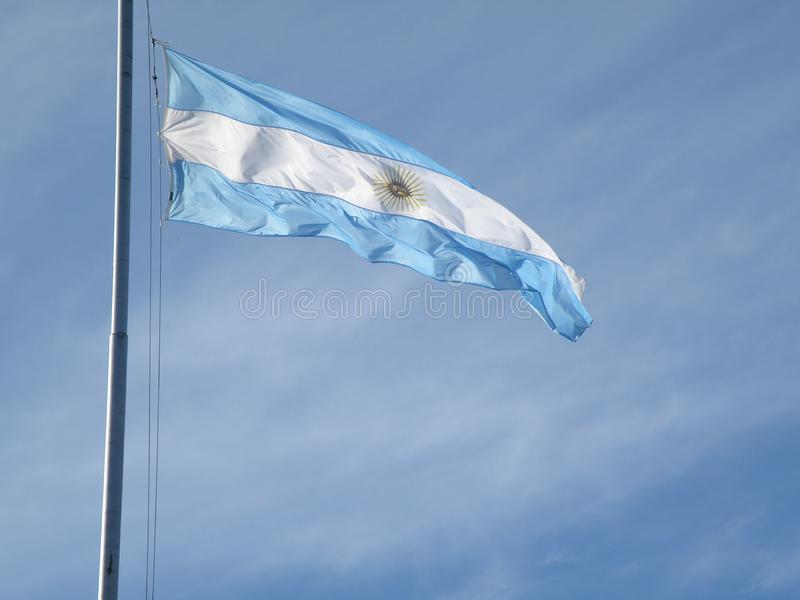 Argentinian flag ondulated by the windy wheather. Argentinian flag being moved by the windy wheather with blue sky on the background stock photo