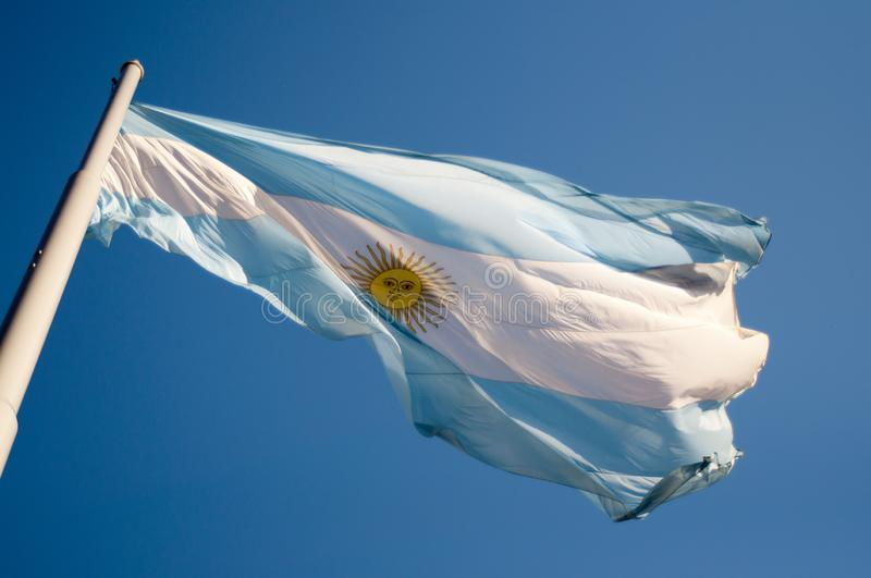 Argentinian flag waving on a sunny day against the blue sky en Buenos Aires Argentina stock image