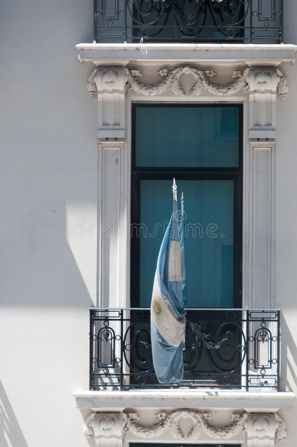 Argentinian Flag in a window. Image of the Argentinian Flag as seen from a balcony across the street royalty free stock photography