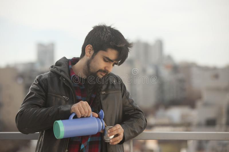 Argentinian man drinking mate ourdoors in Buenos Aires city. Argentina royalty free stock photos