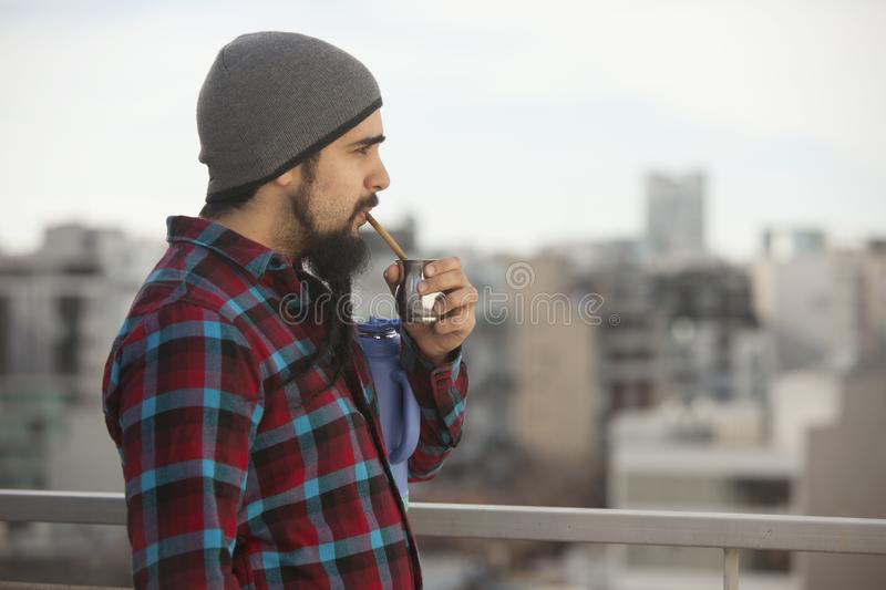 Argentinian man drinking mate ourdoors in Buenos Aires city. Argentina stock photos