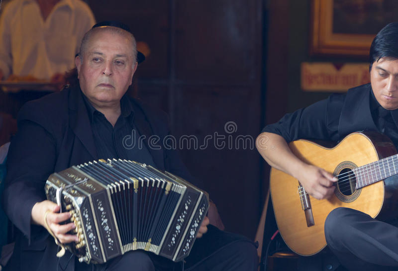 Argentinian musicians playing music in La Bocca in Buenos Aires, Argentina. stock image