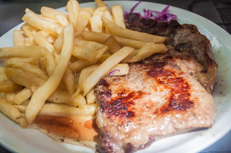 Argentinian steak. In a restaurant in Mendoza, Argentina royalty free stock photography