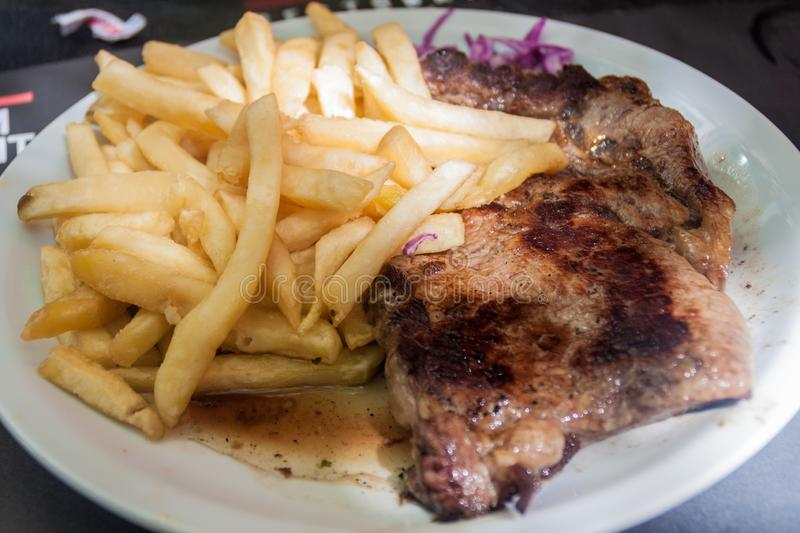 Argentinian steak. In a restaurant in Mendoza, Argentina royalty free stock image