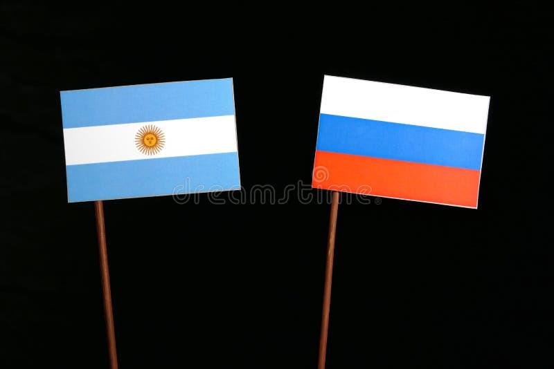 Download Argentinische Flagge Mit Der Russischen Flagge Lokalisiert Auf Schwarzem Stockbild - Bild von freundschaft, niemand: 96932085