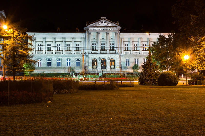 Arges county museum in Pitesti. PITESTI, ROMANIA - SEPTEMBER 12, 2012: The Arges county museum in Pitesti city, Romania, by night stock photography