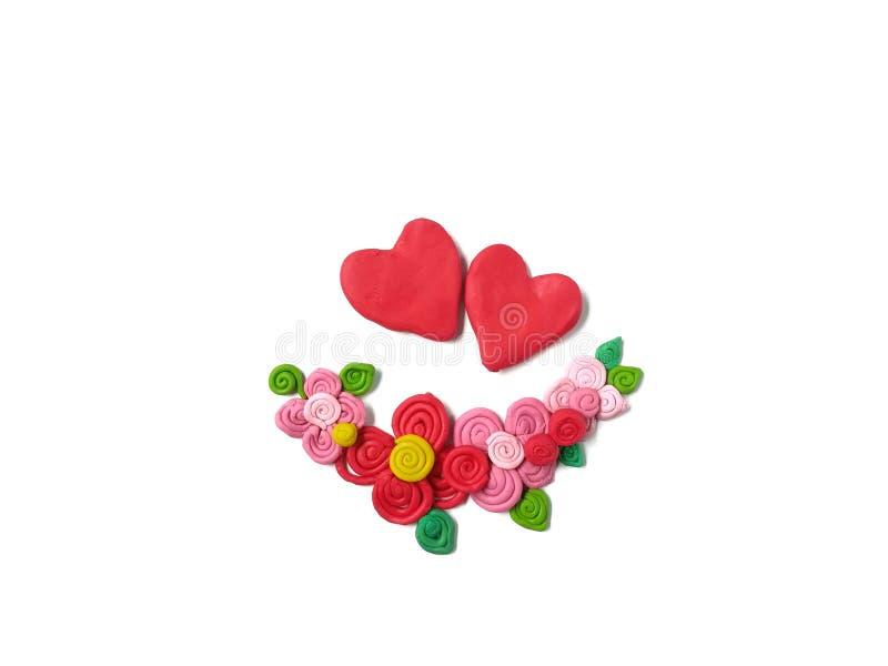 Argila bonito do plasticine do coração dos pares, massa da flor do ramalhete, dia do ` s do Valentim fotografia de stock