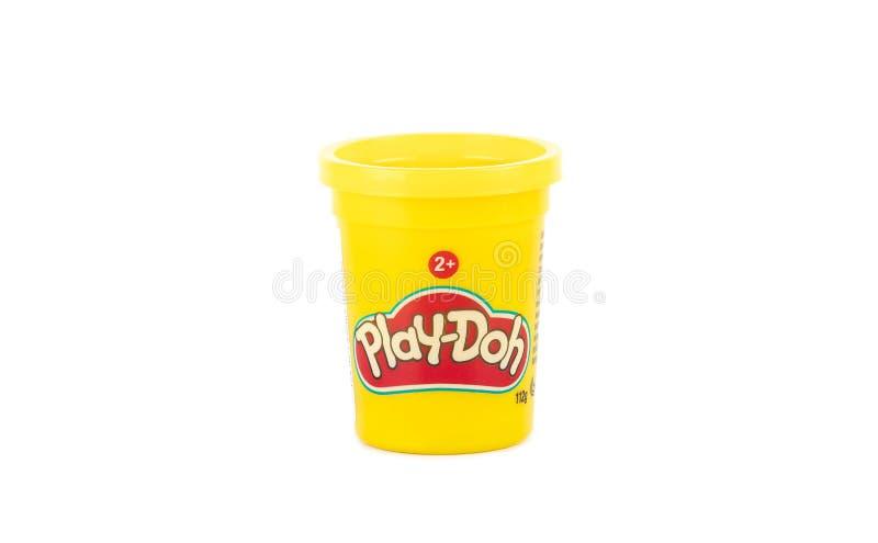Argile de Play-Doh dans un petit conteneur jaune avec la couverture jaune photos stock