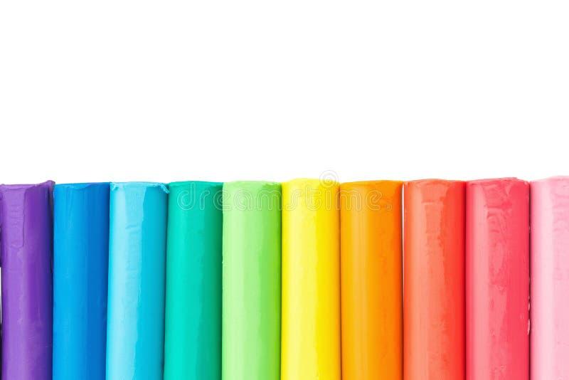 argile plasticine Pâte de jeu plan rapproché coloré de mur d'isolement dessus image stock