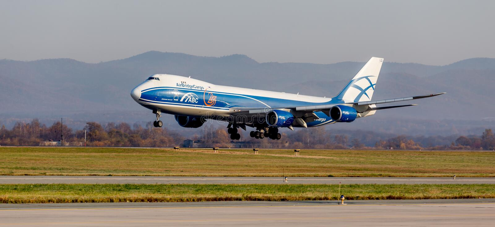 Argo jet aircraft Boeing 747-BF of AirBridgeCargo Airlines is landing. Aviation and transportation. Russia, Vladivostok, 10/13/2017. Cargo jet aircraft Boeing stock images