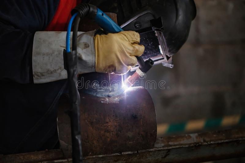 Argon arc welding control sample of carbon steel pipes. The sample is a pipe element with a pipe-to-pipe insert stock photography