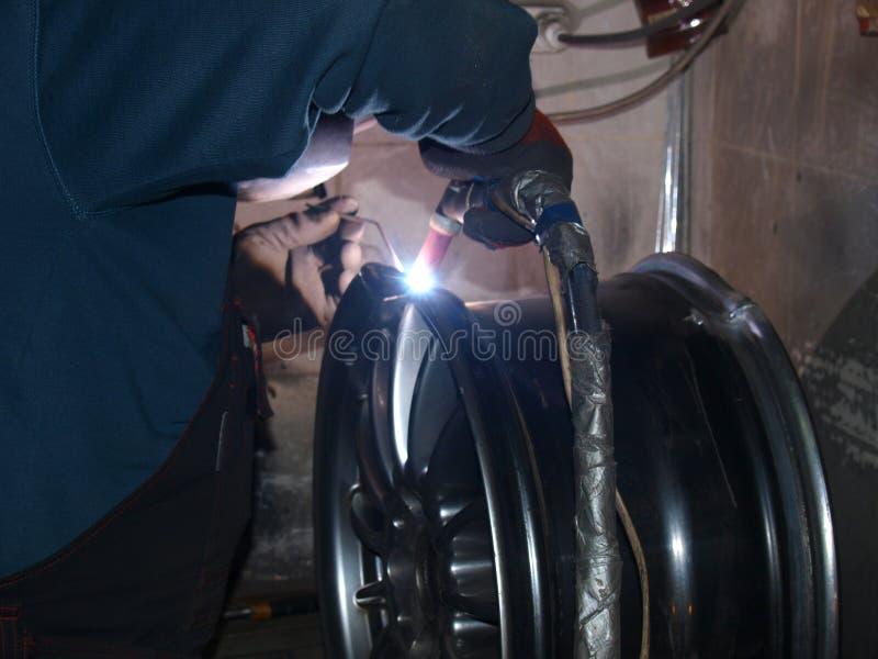 Argon arc welding. Argon-arc welding,titanium disk,repair royalty free stock photo