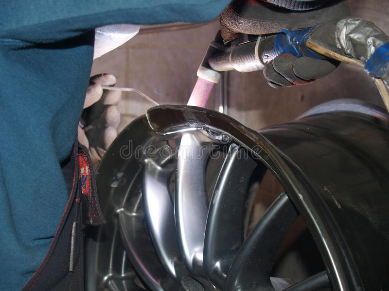 Argon arc welding. Argon-arc welding,titanium disk,repair royalty free stock photography