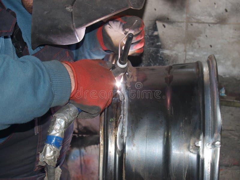 Argon arc welding. Argon-arc welding,titanium disk,repair stock image