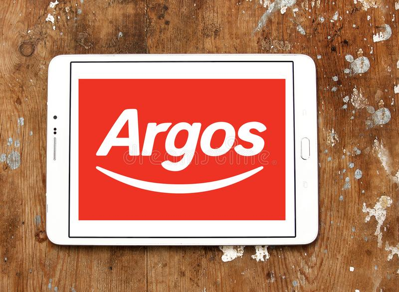 Argos retailer logo. Logo of Argos retailer on samsung tablet on wooden background. Argos, is a British catalogue retailer operating in the United Kingdom and royalty free stock images