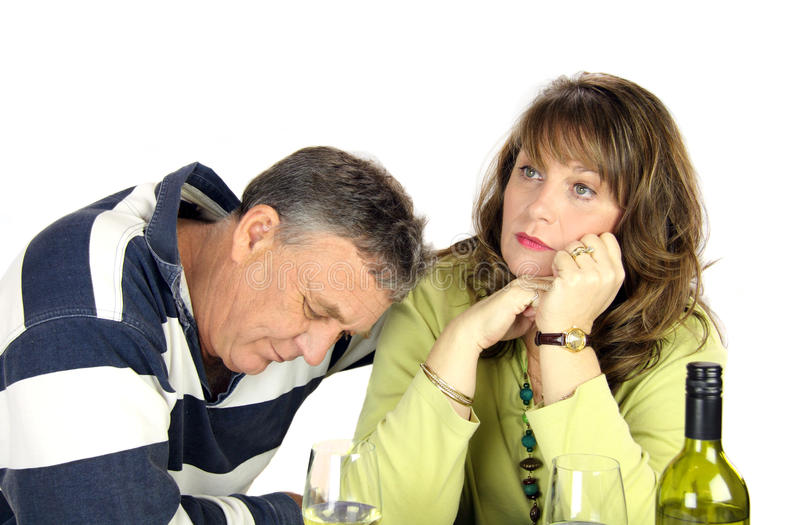 Arguing Couple. Dejected middle aged couple after having had an argument royalty free stock photo