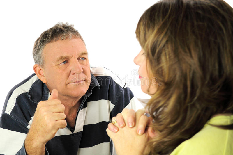 Arguing Couple. Upset and emotional middle aged couple after an argument royalty free stock photos