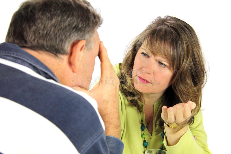 Arguing Middle Aged Couple. Upset and emotional middle aged couple after an argument royalty free stock images