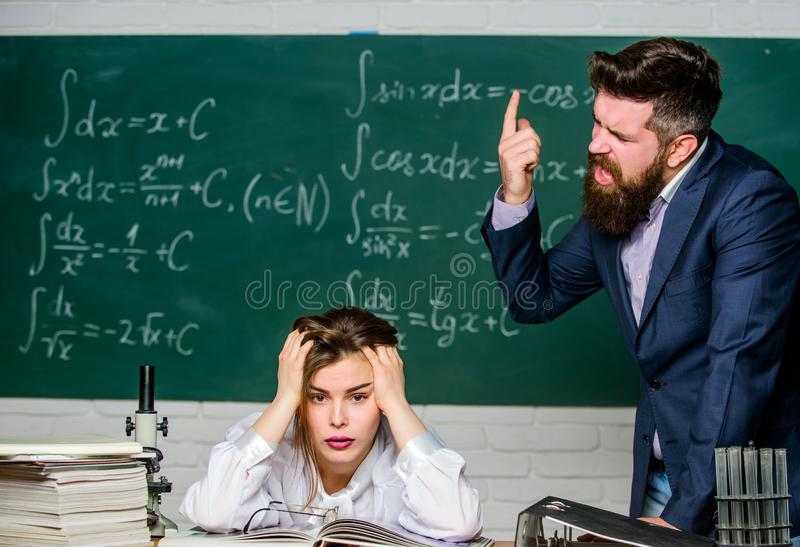 Arguing about study. Conflict situation. School conflict. Demanding lecturer. Teacher strict serious bearded man having. Conflict with student girl. Rebuke and royalty free stock photos