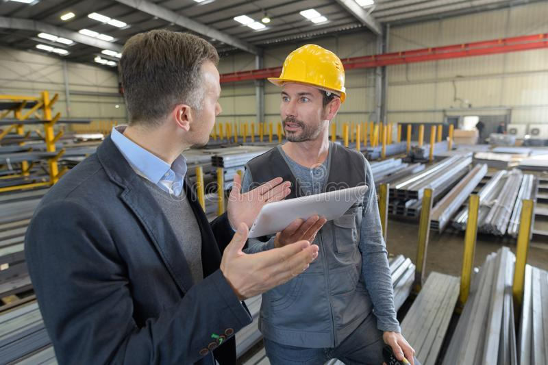 Argument between boss and worker. Argument between the boss and the worker stock photo