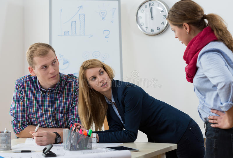Argument at workplace stock images