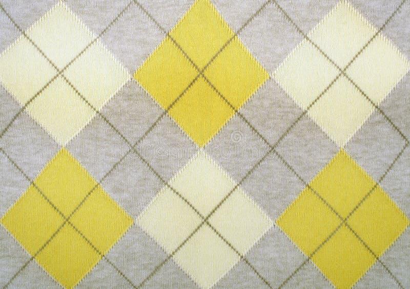 Argyle pattern on a sweater. Close up shot stock photo